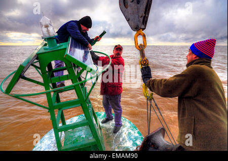 Working on board at beaconing ship at Demarchi Island Port, River Plate  Coast. Buenos Aires, Argentina - Stock Photo