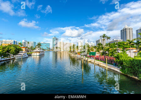 luxury houses at the canal in Miami Beach with boats - Stock Photo