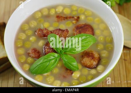 appetizing pea soup with bacon and sausage - Stock Photo