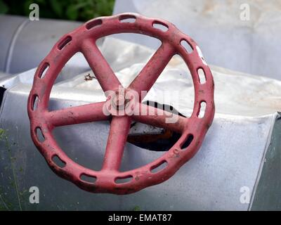 red old valve and metal pipeline - Stock Photo