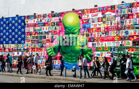 New York, USA 18 April 2016 - Bowery Mural featuring street artist Ron English with 'an American flag composed of - Stock Photo