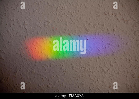 Natural light reflection on the wall as a rainbow. Color spectrum - Stock Photo