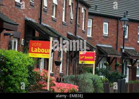 Didsbury, Manchester, UK. 19th April, 2015. General Election  Two adjoining houses in Grove Lane, Didsbury in the - Stock Photo
