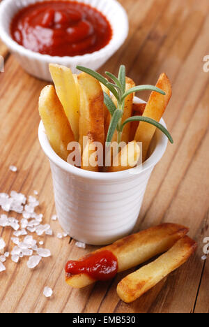 portion of french fries with ketchup - Stock Photo