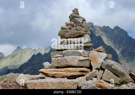Pile of stones in the mountains - Stock Photo