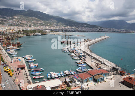 View of the Mediterranean seaport of Alanya in Turkey viewed from the Red Tower fortress designed to defend the - Stock Photo