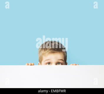Portrait of the small shy kid - Stock Photo
