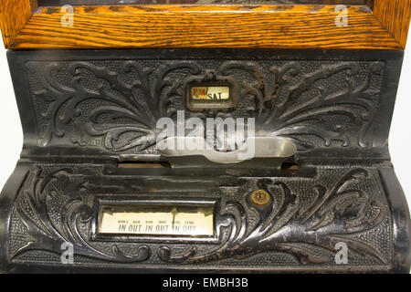 Antique time clock or punch clock metal. - Stock Photo
