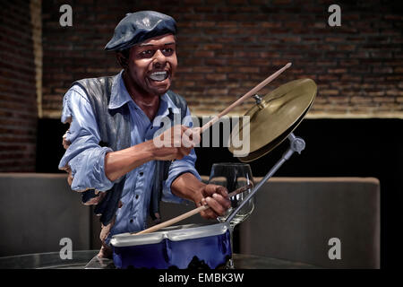 Wine bar advertising with a statue of an African-American man playing the drums - Stock Photo
