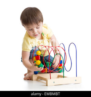 child boy playing with colorful toy - Stock Photo