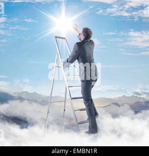 Young smart businessman on the top of his career - Stock Photo