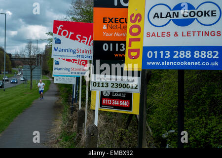 Row of estate agents signs for renting and houses for sale in Leeds West Yorkshire United KIngdom - Stock Photo