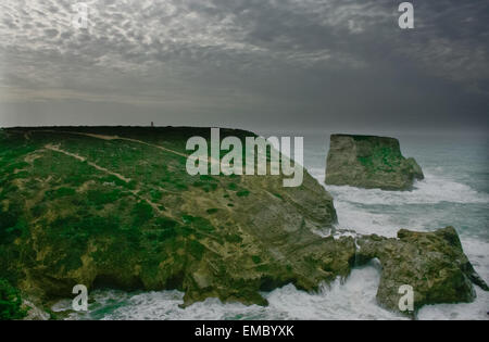 Stormy sunset at Saint Vicent cliffs, Algarve, Portugal - Stock Photo