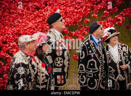 A generation of pearly kings and queens on armistice day at the Tower of London, UK. - Stock Photo
