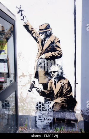 Detail of Banksy's 'spy booth' artwork appeared in Cheltenham, Gloucestershire in April 2014. - Stock Photo