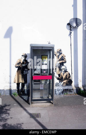 Banksy's 'spy booth' artwork appeared in Cheltenham, Gloucestershire in April 2014. - Stock Photo