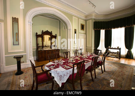 Ireland, Co Galway, Connemara, Kylemore Abbey, Dining Room with table laid - Stock Photo