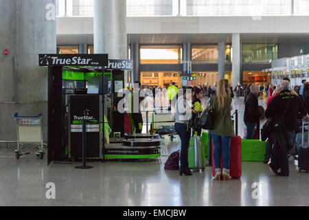 Luggage wrapping service at Malaga Airport Spain - Stock Photo