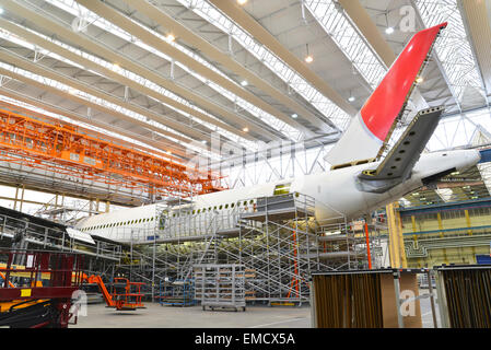 Airplane construction in a hangar - Stock Photo