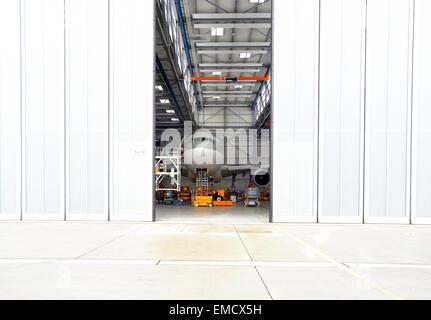 Airplane in a hangar - Stock Photo