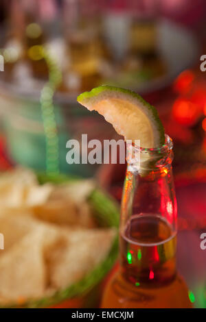 Focus on lime in beer bootle, Cinco de Mayo Party - Stock Photo