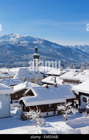 Germany, Bavaria, Upper Bavaria, Chiemgau, View to Reit im Winkl in winter, Unterberghorn in the background - Stock Photo