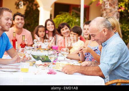 Large Family Group Celebrating Birthday On Terrace Together - Stock Photo