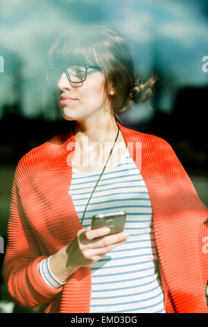 Young businesswoman using moblie phone - Stock Photo