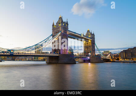 A view of Tower Bridge at Dusk. Buildings from the City of London can be seen in the background. Copyspace can be - Stock Photo