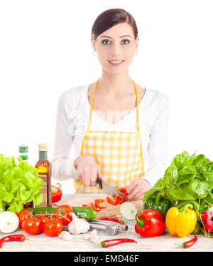 Smiling woman preparing salad. Healthy food and diet concept. Isolated on white. - Stock Photo