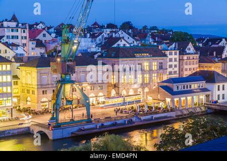 Switzerland, Zurich, Limmatquai in the evening - Stock Photo
