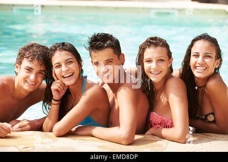 Portrait Of Teenage Friends Having Fun In Swimming Pool - Stock Photo