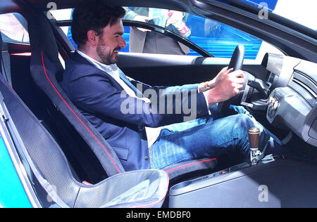 Shanghai, China's Shanghai, China. 20th Apr, 2015. A man tries a vehicle during the Auto Shanghai 2015, east China's - Stock Photo