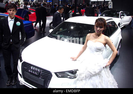 Shanghai, China's Shanghai, China. 20th Apr, 2015. Models stand by a vehicle displayed in the Auto Shanghai 2015, - Stock Photo