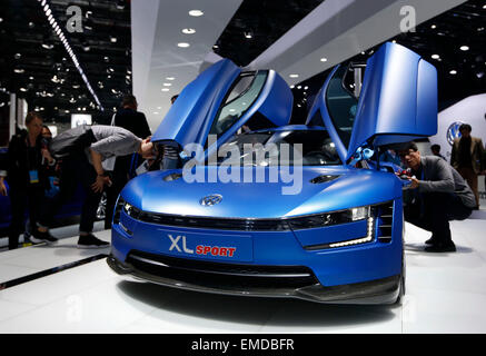 Shanghai, China's Shanghai, China. 20th Apr, 2015. Visitors look at a vehicle displayed in the Auto Shanghai 2015, - Stock Photo