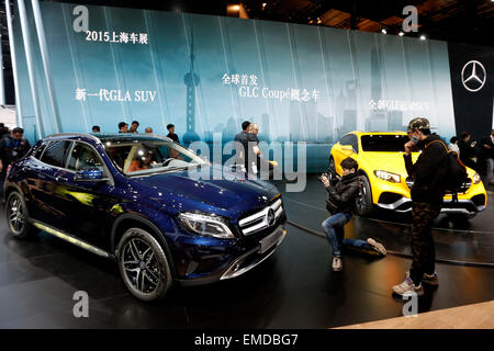 Shanghai, China. 20th Apr, 2015. Visitors look at vehicles of Benz displayed in the Auto Shanghai 2015, east China's - Stock Photo