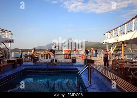 Holidaymakers on the lido deck of a cruise ship, Lofoten Isles, Nordland, Norway, Scandinavia, Europe - Stock Photo