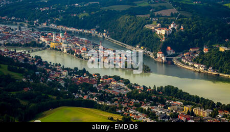Confluence of three rivers Danube, Inn and Ilz, Passau historic centre, Veste Upper House behind, Lower Bavaria, - Stock Photo