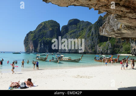 Boats, tourists, sand and sea on tropical Maya Beach, Koh Phi Phi Leh, looking out to the Andaman Sea, Krabi Province, - Stock Photo