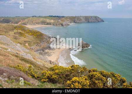 Elevated view down to Three Cliffs Bay from Great Tor in spring on Gower Peninsula. Penmaen Swansea West Glamorgan - Stock Photo