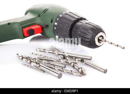 Drill and set of drill bits on white - Stock Photo