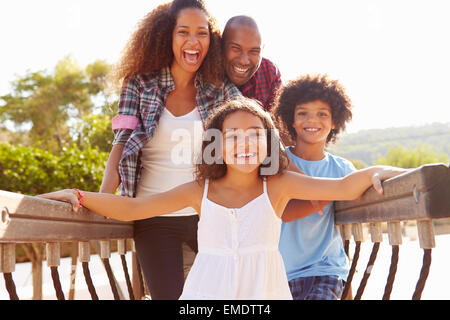 Portrait Of Family On Playground Climbing Frame - Stock Photo