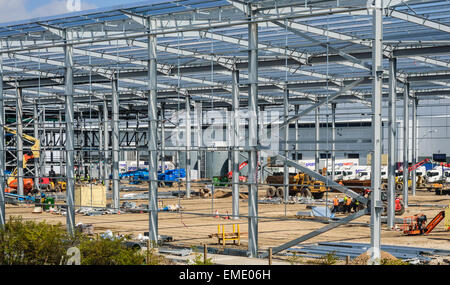 Construction site on Sports Direct property. Metal girder framework being constructed. In Shirebrook, Nottinghamshire, - Stock Photo