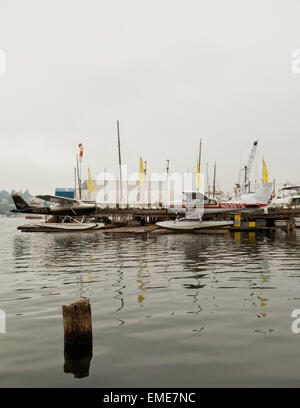 Seaplanes on a misty Lake Union Seattle Washington USA - Stock Photo