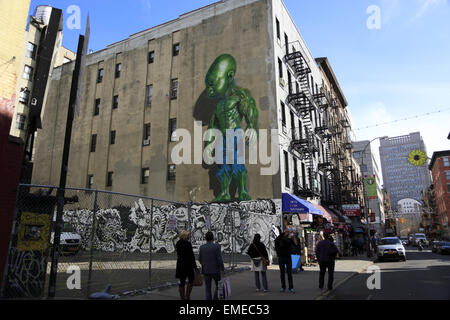 Street view of Green Baby Hulk mural by Ron English on the wall of Mulberry Street Little Italy Manhattan New York - Stock Photo