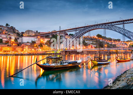 Porto, Portugal old town skyline on the Douro River with rabelo boats. - Stock Photo