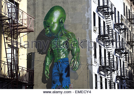 Green Baby Hulk mural by Ron English on the wall of Mulberry Street Little Italy Manhattan New York USA - Stock Photo