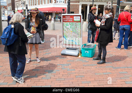 Harvard University tourists meet with tour guides in Cambridge, Massachusetts, USA. - Stock Photo