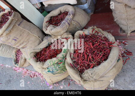 Open sacks of chillies on display outside an open-fronted shop in Mattancherry - Stock Photo