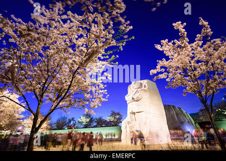 Crowds gather under the Martin Luther King, Jr. Memorial in West Potomac Park in Washington DC. - Stock Photo